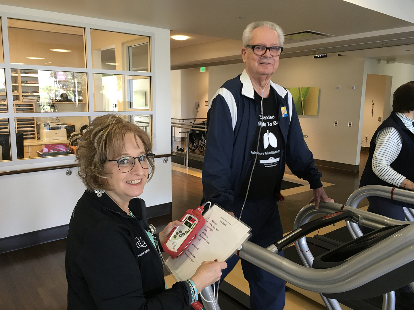 Doctor and pulmonary rehabilitation patient on a treadmill